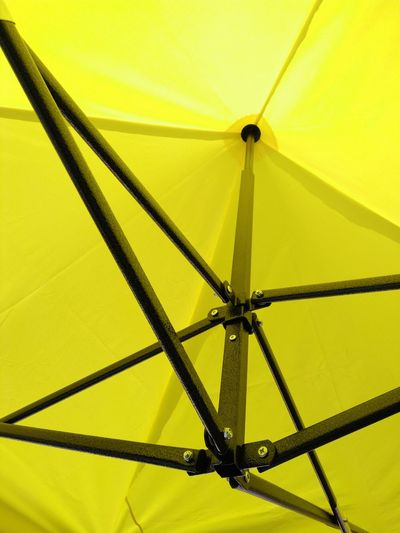 Under yellow foldable tent, in a sunny day. Outdoor Equipment Party Equipment Foldable Tent Events Equipment Yellow Protection Sunshade
