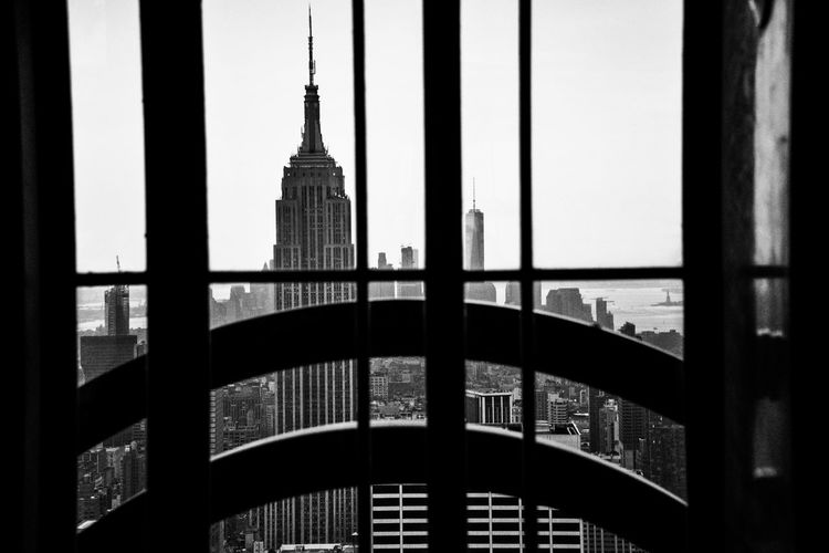 A view worth remembering. From this vantage point you can see the Empire State Building Freedom Tower and the Statue Of Liberty all in one shot. Empirestatebuilding Freedomtower Statueofliberty Ontopoftherock New York City New York Scenic View Scenic Landscapes Iconic Buildings Iconic New York NYC Blackandwhitephotography Black And White Photography Blackandwhite Window View