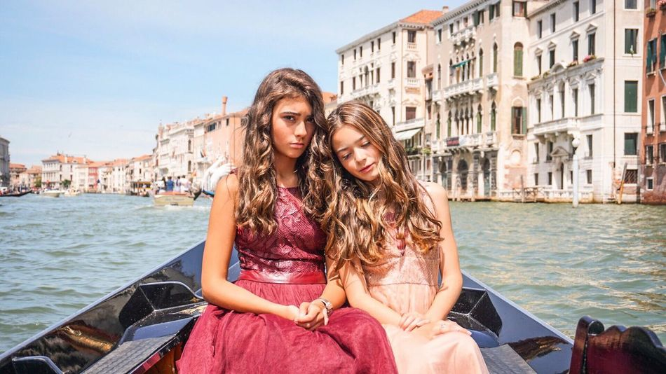 👸🏻👸🏼 Long Hair Sitting Building Exterior Architecture Travel Destinations Outdoors Built Structure Day Gondola - Traditional Boat Two People Togetherness Vacations Water Only Women City People Friendship Venetian Venezia Sky Young Adult Venice, Italy Venice The Fashion Photographer - 2018 EyeEm Awards