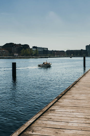 Copenhagen waterfront Denmark Architecture Blue Blue Sky Boat Building Exterior Built Structure Clear Sky Copenhagen Day Mode Of Transportation Nature Nautical Vessel No People Ocean Outdoors Pier River Sea Sky Transportation Travel Water Waterfront Wood - Material