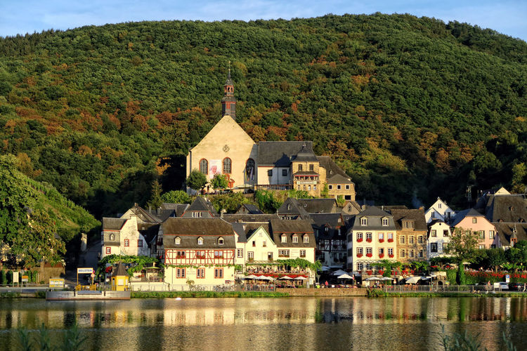Moselle river against buildings and mountains