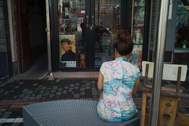 Rear view of woman on window