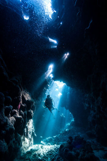 Scuba diver amidst rocks in red sea