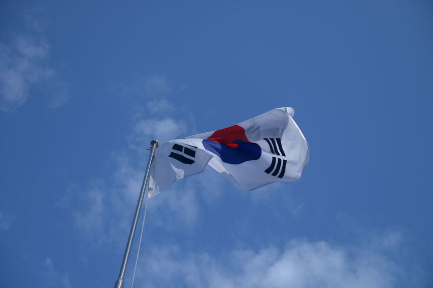 Sky Low Angle View Patriotism Flag Wind Blue Cloud - Sky Pole Environment Nature Waving Day No People White Color Motion Freedom National Icon Independence Outdoors Korean Flag