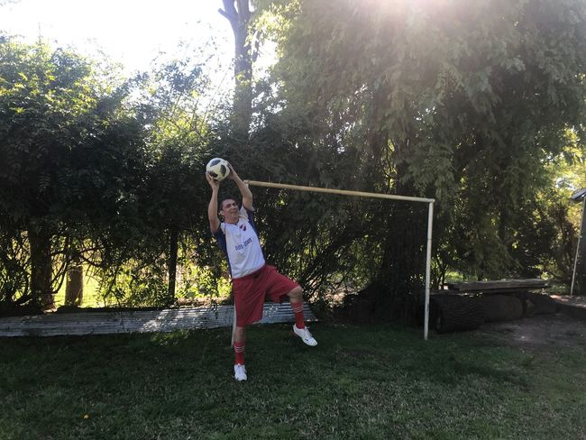 Goalkeeper Soccer Goalkeeper Soccer Player Full Length One Person Real People Leisure Activity Plant Lifestyles Tree Childhood Nature Sunlight Casual Clothing Day Child Grass Lens Flare Outdoor Play Equipment Outdoors
