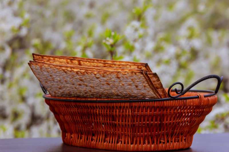 Close-Up Of Crackers In Wicker Basket On Table