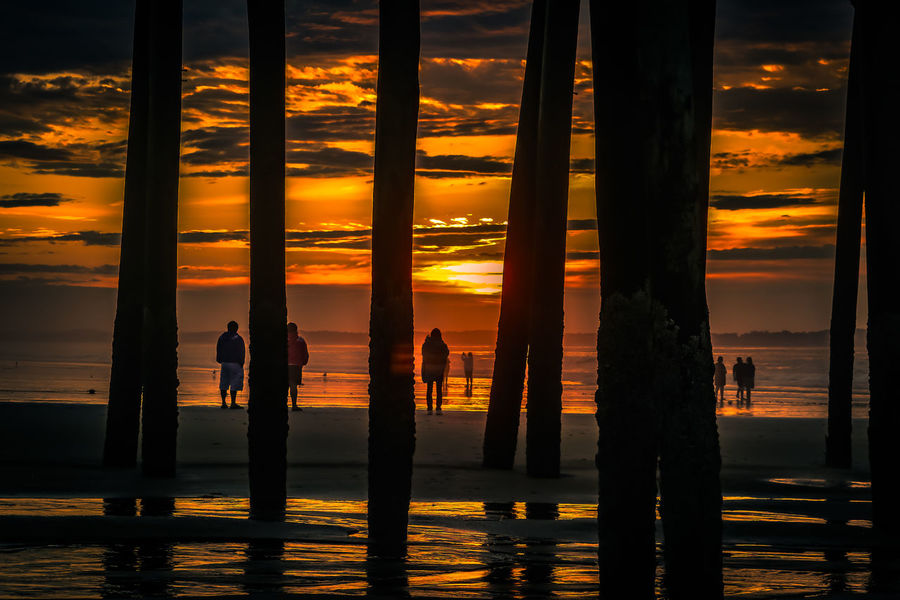EyeEmNewHere Under Pier Beach Beauty In Nature Cloud - Sky Horizon Over Water Lifestyles Main Men Nature Orange Color Outdoors People Real People Scenics Sea Silhouette Sky Standing Sun Sunrise Togetherness Tranquil Scene Tranquility Water