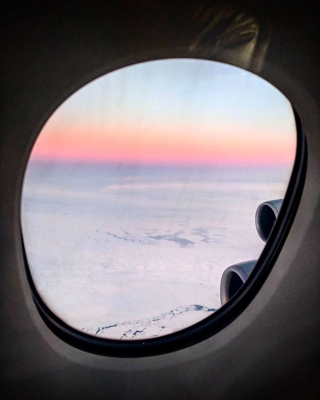 sky, sea, beauty in nature, cloud - sky, sunset, scenics, horizon over water, nature, no people, circle, window, tranquil scene, water, tranquility, landscape, airplane, air vehicle, vehicle part, indoors, close-up, day, airplane wing