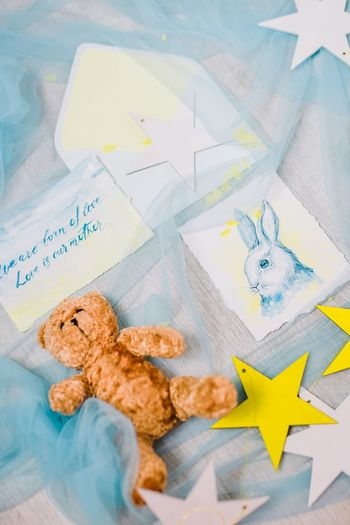 High angle view of stuffed toy and greeting card
