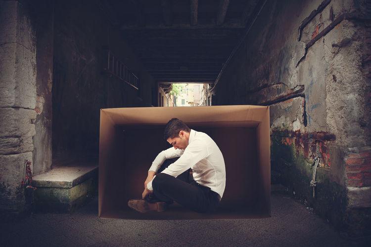 Man sitting in box