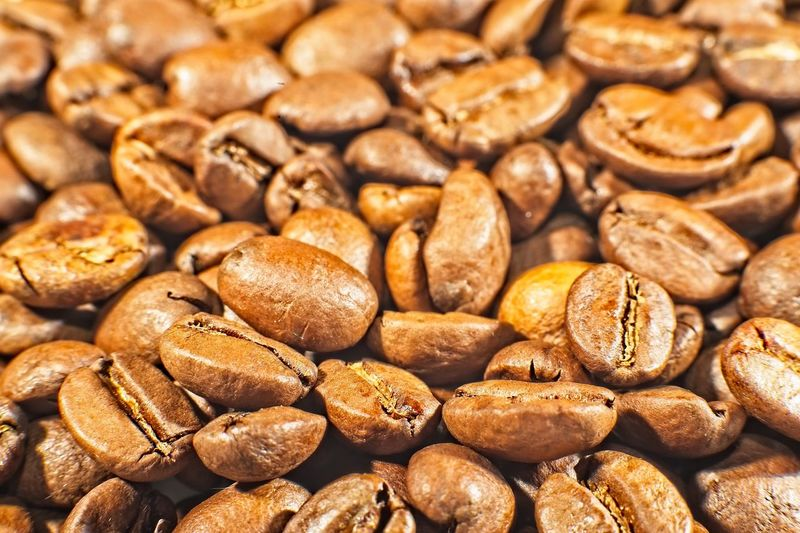 Coffea arabica roasted beans macro Beans Beverage Dark Seed Arabica Aroma Backgrounds Brown Caffee Close-up Coffe Coffee Bean Energy Energydrink Food Food And Drink Full Frame Gourmet Grain Raw Coffee Bean Roasted Stimulant Texture