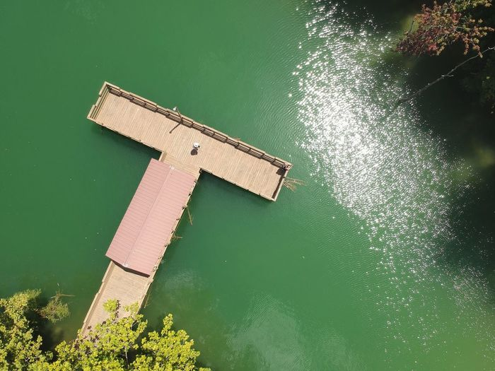 Aerial view of pier by lake