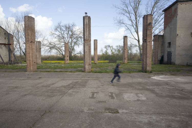 Architectural Column Architecture Building Exterior Built Structure Child Childhood Children Only City Day History Motion One Person Sky
