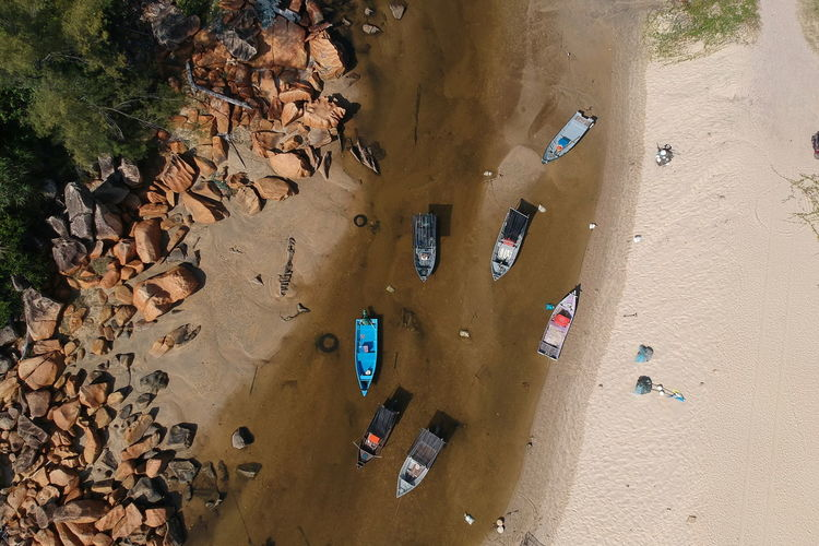 Beach Beauty In Nature Car Day High Angle View Land Land Vehicle Leaf Mode Of Transportation Motor Vehicle Nature Outdoors Plant Part Real People Sand Scenics - Nature Sunlight Transportation Water