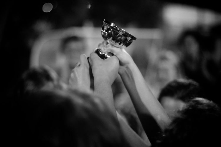 Sports team holding trophy at night