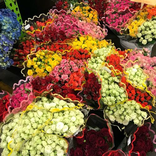 Multi colored flowers on market stall