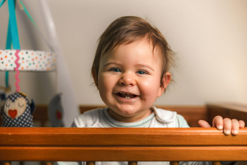 Babies Of Eyeem Blue Eyes Baby Bed Blonde Domestic Life Teething Wood Baby Boy Boy Childhood Close-up Cot Bed Cute Day Full Frame Happiness Home Interior Indoors  Looking At Camera Mobile One Person Portrait Real People Smiling Teeth Toy EyeEmNewHere Love Yourself