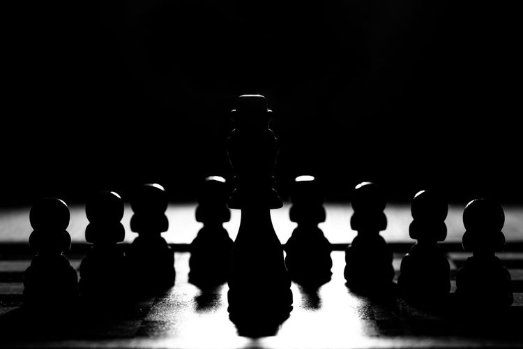 Close-up of chess board against black background