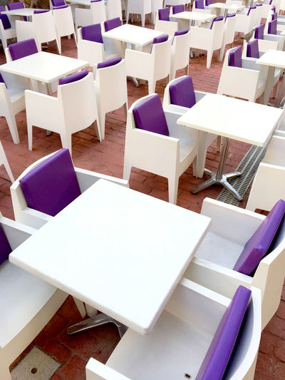 High Angle View Of Tables And Chairs Arranged At Restaurant