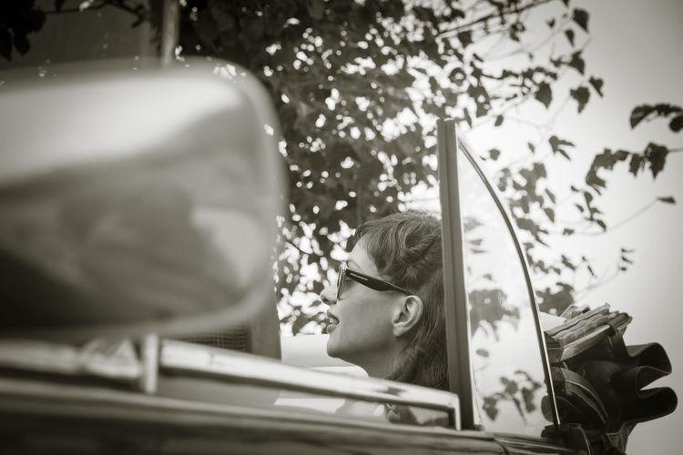 Woman In Convertible Car