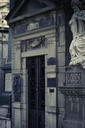La Recoleta Cemetery, Buenos Aires, Argentina Upper class death in Argentina. The myriad of tombs and mausaleums open to the public housing the wealthy and famous of Argentine society. A macabre place of death and celebration. The Photojournalist - 2018 EyeEm Awards Architectural Column Architecture Art And Craft Bas Relief Building Building Exterior Built Structure Carving Carving - Craft Product Communication Craft Creativity Day History Human Representation Male Likeness No People Ornate Outdoors Representation Sculpture Statue Text The Past Travel Destinations