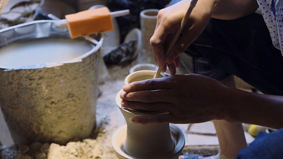 High angle view of man making pot