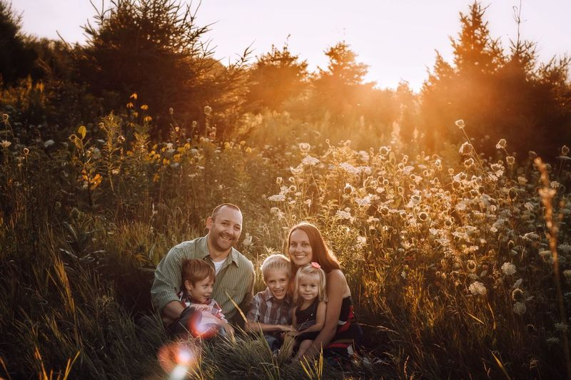 Family portrait. Child Family Females Father Males  Mother Girls Boys Daughter Sunset Togetherness Son Love Childhood Parent Happiness Men Family With Two Children Smiling Nature