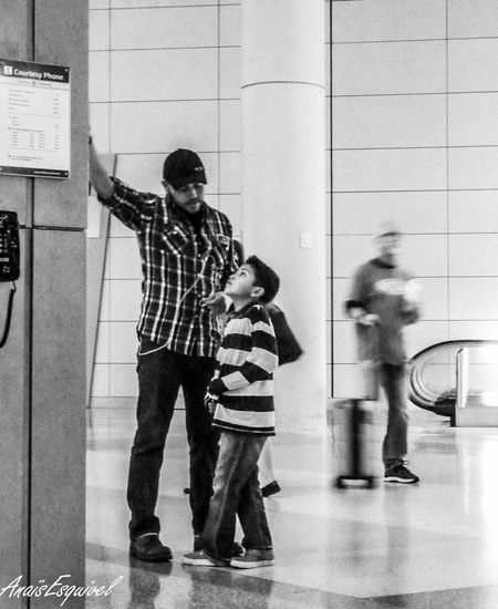 Father and Son Airport Photography Father And Son Time Black And White Photography Helping The World