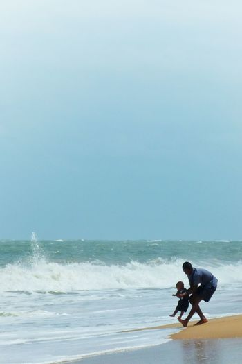 Manakara Madagascar  Africa Beach Waves Ocean Father & Son Playing People Watching People Travel Traveling Landscapes Splash Water Blue Wave People Of The Oceans Fatherhood Moments