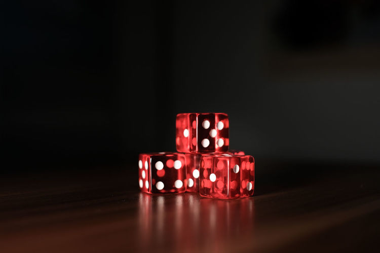 Close-up of illuminated red light on table