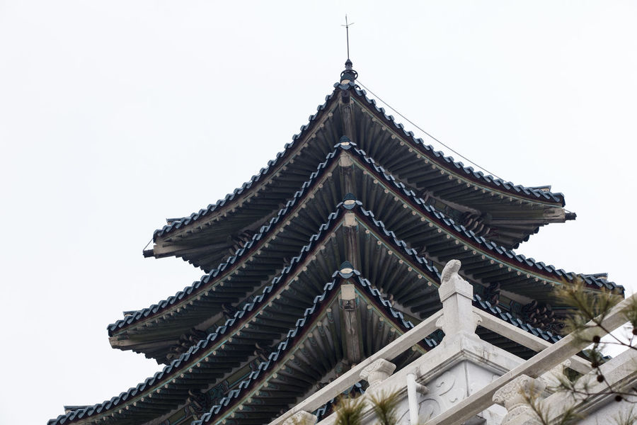 Architectural Feature Architecture Building Exterior Built Structure Clear Sky Copy Space Famous Place Gyungbok Palace Historic Place International Landmark Low Angle View National Museum Outdoors Place Of Worship Religion Sky Spirituality Tall - High Temple - Building Tourism Tower Travel Travel Destinations