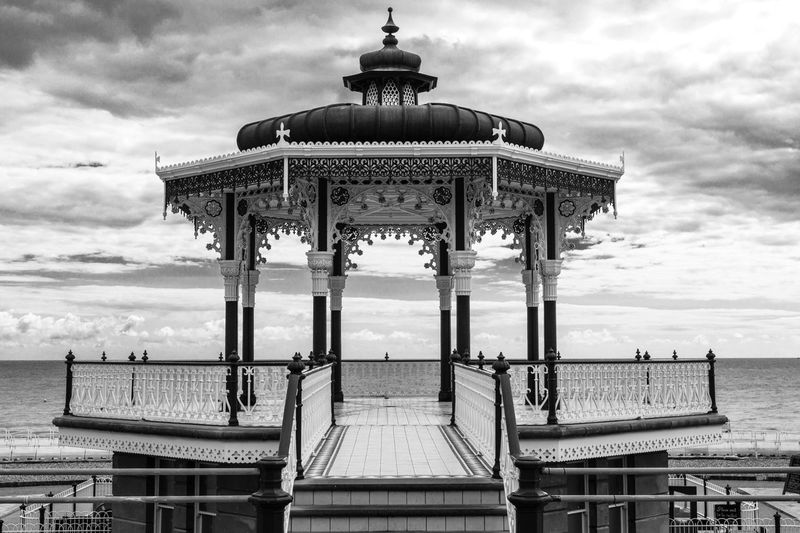 Bandstand Over Sea Against Cloudy Sky