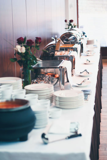 Buffet lunch with chafing dishes food warmers roll tops dinnerware Buffet Time Chafing Dish Dinner Dish Dishes Lunch Ready Service Table Setting Bar Buffet Buffet Dinner Buffet Food Day Dinnerware  Food Hotel Indoors  Indoors  Long No People Restaurant Table Warmer