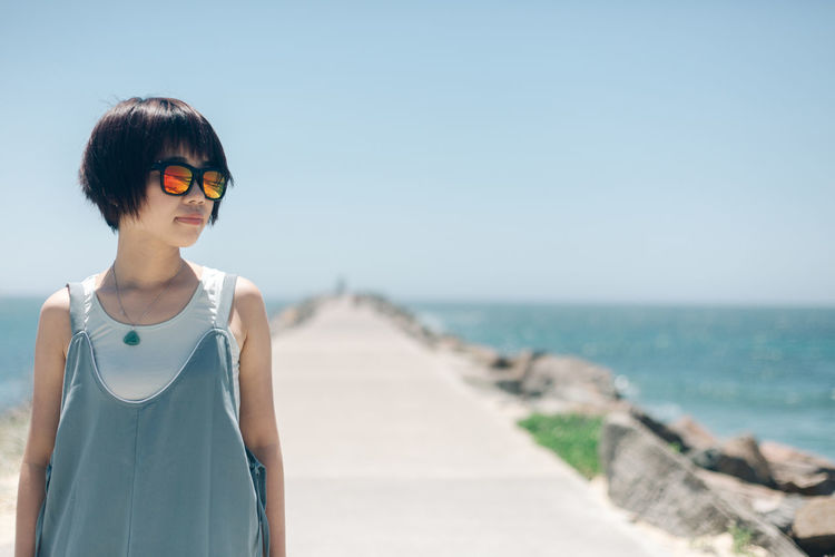Sea Glasses Water Beach Sky Fashion One Person Sunglasses Horizon Horizon Over Water Land Standing Young Adult Nature Casual Clothing Focus On Foreground Lifestyles Day Leisure Activity Front View Outdoors Beautiful Woman Hairstyle Travel Destinations People Portrait