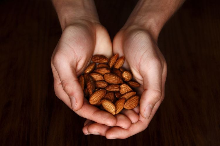 Cropped Hands Holding Almonds