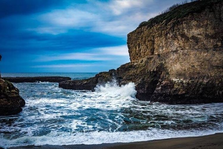 Shark Fin Cove in Davenport, CA Sea Scenics Rock - Object Beauty In Nature Water Nature No People Outdoors Tranquility Sky Day Motion Horizon Over Water Tranquil Scene Wave Cloud - Sky Power In Nature Ocean First Eyeem Photo