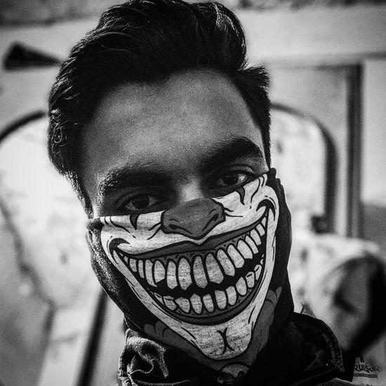 Close-up portrait of man wearing mask