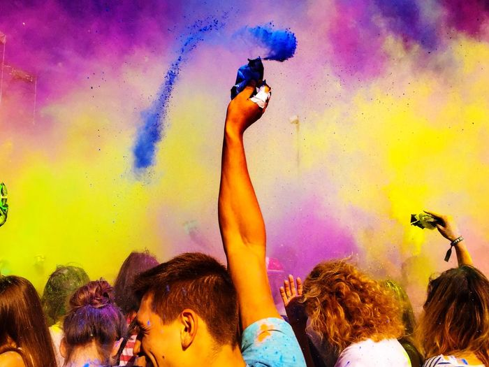 People enjoying with powder paint