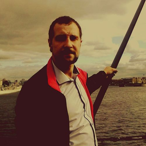 Portrait Waist Up Mid Adult One Man Only Only Men One Mid Adult Man Only Smiling Cloud - Sky Businessman Looking At Camera Adults Only Outdoors One Person Mid Adult Men Sea Well-dressed Business Suit Men Water Cruiser Aurora,Saint Petersburg