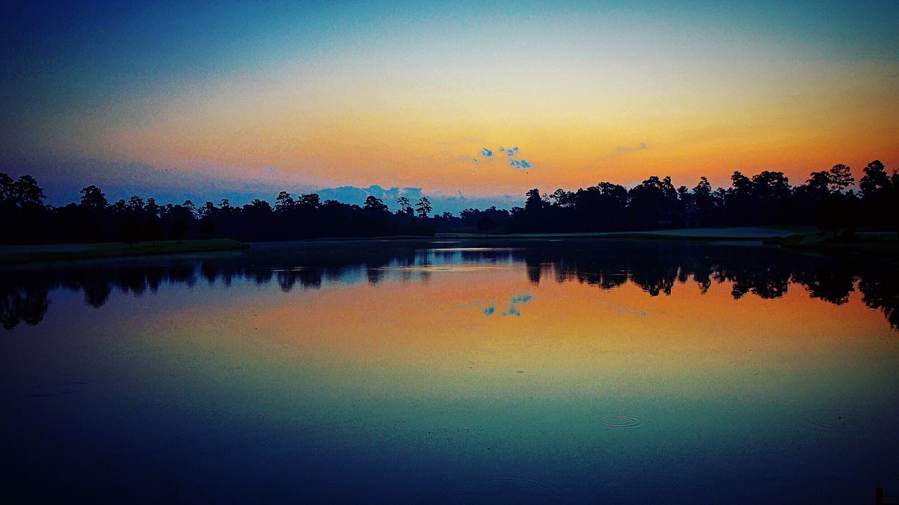 reflection, sunset, silhouette, nature, tranquil scene, tree, beauty in nature, lake, scenics, water, tranquility, sky, outdoors, no people, bird, flying, animal themes, day