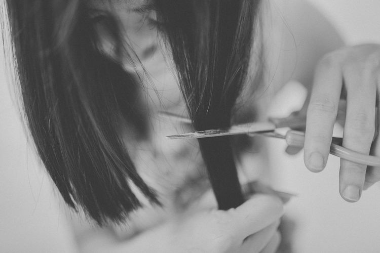 Close-up of woman cutting hair