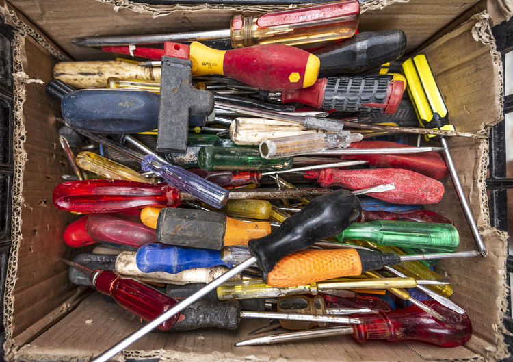 Messy Work Abundance Box Choice Close-up Container Day Directly Above High Angle View Indoors  Large Group Of Objects Multi Colored Pen Red Screwdriver Screwdrivers Still Life Toolbox Tools Variation Wood - Material Work Tool Yellow