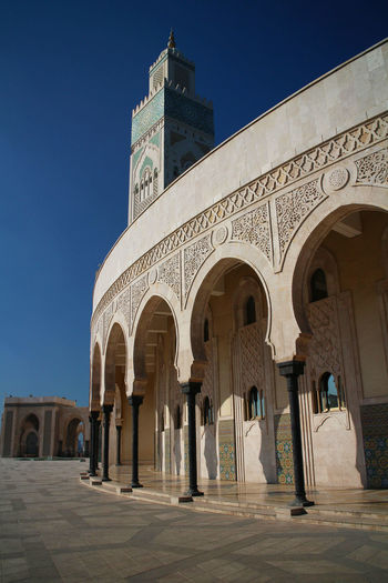 Modern Worship Arch Architecture Archways Building Exterior Built Structure Cassablanca Mosque Clear Sky Curved  Day History Minaret Mosque Mosque Hassan II No People Outdoors Pillars Religion Sky Travel Destinations