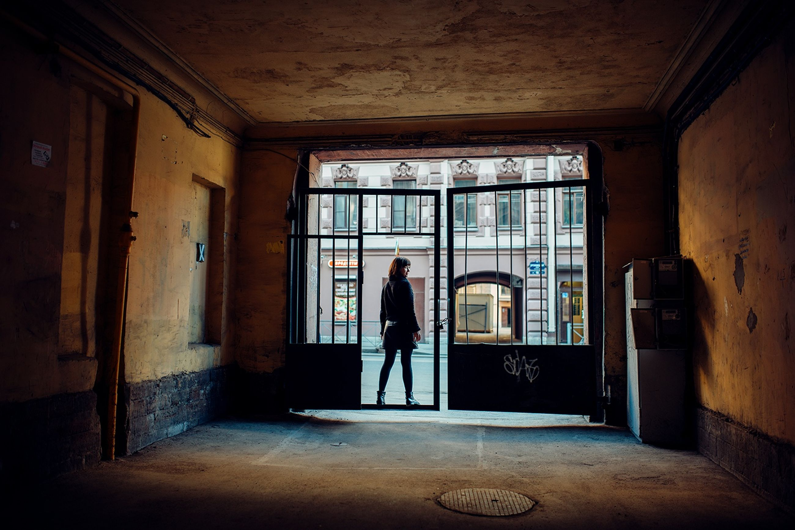 indoors, one person, full length, architecture, window, entrance, day, standing, real people, adult, building, door, built structure, casual clothing, women, walking, men, looking, leaving