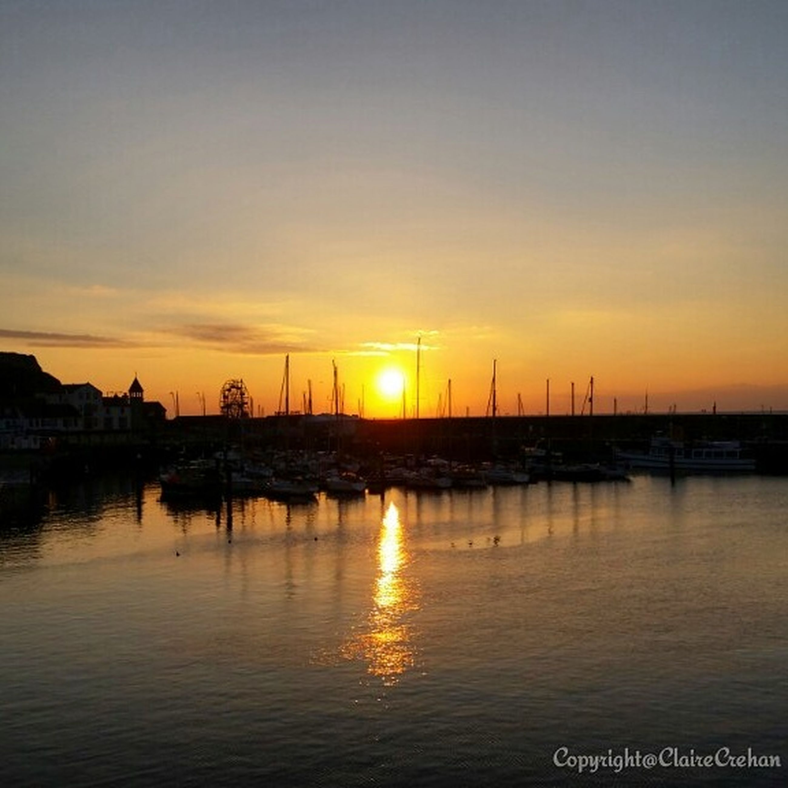 sunset, water, orange color, sun, reflection, tranquil scene, scenics, silhouette, tranquility, beauty in nature, transportation, nautical vessel, waterfront, sea, sky, idyllic, nature, boat, lake, moored