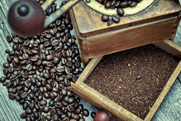 Old coffee grinder with ground coffee and coffee beans on a wooden background. Dark Arabika Caffeine Coffee Ground Coffee Mocha Aroma Brown Cafe Close-up Coffee Bean Coffee Grinder Day Drink Food Food And Drink Freshness Kitchen Old Old Coffee Grinder Retro Styled Roasted Coffee Bean Traditional Vintage Wooden Background