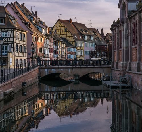Aaah-lsace. Architecture Water Building Exterior Built Structure Reflection Canal Outdoors City Multi Colored Colorful Colors Colmar, Alsace, France Colmar Water Reflections France Vive La France Alsace Travel Photography Traveling Travel Travel Destinations Dusk Sunset Architecture Architecture_collection