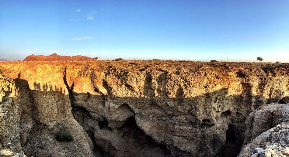Canyon Our Shadows  Magic Hour Warm Light Sossusvlei Enjoying Nature Namibia People Shadow Namib Desert Sunset Sunset_collection Sunset Silhouettes IPhoneography Travel Photography Amazing Nature Amazing Place Roadtrip