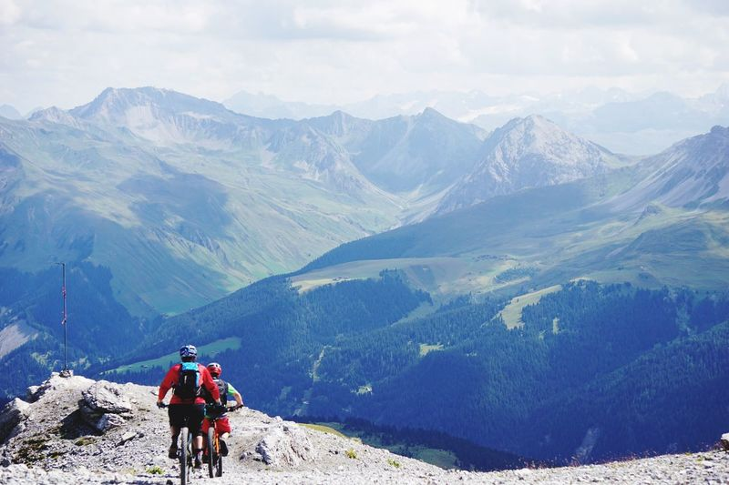 Mountain bikers going downhill in Arosa EyeEm Selects Mountain Bike Trail. Mountain Mountain Range Scenics - Nature Activity Leisure Activity Beauty In Nature Adventure Real People Outdoors Rear View Travel Non-urban Scene Nature Day Tranquility The Great Outdoors - 2019 EyeEm Awards The Great Outdoors - 2019 EyeEm Awards