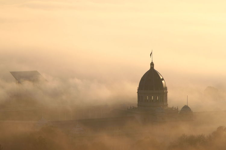 High Angle View Of Royal Exhibition Building Against Sky During Foggy Weather